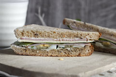 Sandwich on wooden cutting board Royalty Free Stock Photos