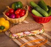 Sandwich on wooden table Stock Image