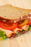 Sandwich  on wooden table. Sandwich close-up image on wooden table Royalty Free Stock Photography