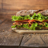 Sandwich on the wooden table royalty free stock photos