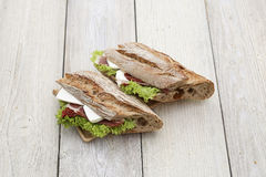 Sandwich on a wooden texture. Close up of sandwich on a wooden texture Royalty Free Stock Photo