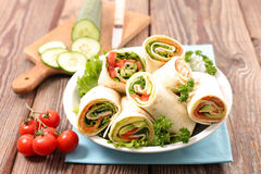 Sandwich wrap,burrito. On wood Royalty Free Stock Images
