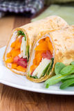 Sandwich wrap portion on plate Stock Photos
