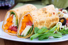 Sandwich wrap portion on plate Stock Photo
