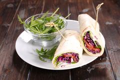 Sandwich wrap with vegetables. And arugula Stock Photo