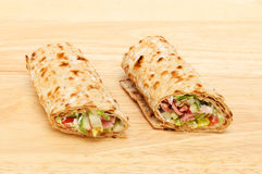 Sandwich wraps on a board Stock Photography