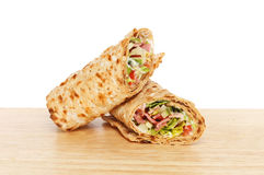 Sandwich wraps on a board Stock Images