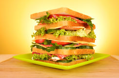 Sandwich on yellow. Sandwich on  the yellow background Royalty Free Stock Image