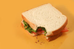 Sandwichbissen Stockfotos