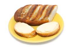 Sandwiche mit Butter auf Untertasse Lizenzfreies Stockfoto
