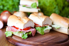 Sandwiches. Wooden board displaying cut sandwiches Royalty Free Stock Photo