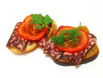 Sandwiches. Sandwiches with sausage, tomatoes, herbs and spices stock image