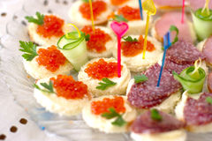 Sandwiches. With salmon caviar and sausages Royalty Free Stock Photos