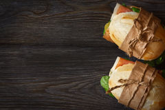 Sandwiches. Prosciutto ham sandwiches with salad on a wooden background with copy space for text Royalty Free Stock Photos