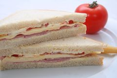 Sandwiches. Fresh sandwiches with cheese and bacon on a plate Royalty Free Stock Images