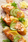 Sandwiches with addition of smoked salmon, cucumber, lemon and black pepper Royalty Free Stock Image