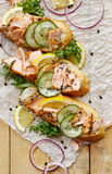 Sandwiches with addition of smoked salmon, cucumber, lemon and black pepper Royalty Free Stock Images