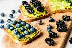 Sandwiches with avocado and berries. healthy vegetarian food.  Royalty Free Stock Images