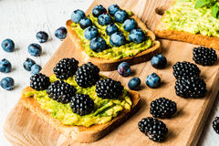 Sandwiches with avocado and berries. healthy vegetarian food.  Stock Photo