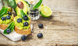 Sandwiches with avocado, blueberries and spinach Stock Photography