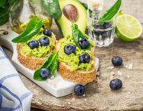 Sandwiches with avocado, blueberries and spinach Stock Photo
