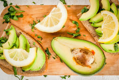 Sandwiches with avocado, lemon and greens Royalty Free Stock Image