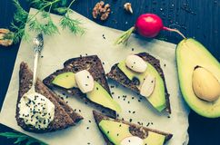 Sandwiches of rye bread with avocado and goat cheese Royalty Free Stock Images