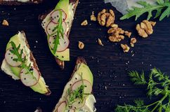 Sandwiches of rye bread with avocado and goat cheese Royalty Free Stock Photography