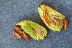 Sandwiches with avocado, sprouts, tomato, dark background, top v Royalty Free Stock Image