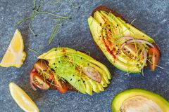 Sandwiches with avocado, sprouts, tomato, dark background, top v Royalty Free Stock Photos