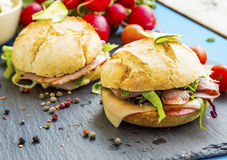 Sandwiches with bacon, cheese, salad and rustic bread Stock Images