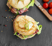 Sandwiches with bacon, cheese, salad and rustic bread Royalty Free Stock Photography