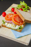 Sandwiches. Bacon, lettuce, Broken egg salad and tomato sandwiches with fresh tomato and lettuce on the wooden board Stock Photography