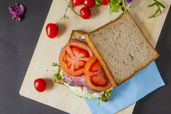 Sandwiches. Bacon, lettuce, Broken egg salad and tomato sandwiches with fresh tomato and lettuce on the wooden board Stock Images