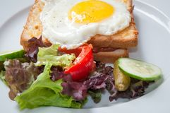 Sandwiches with white bread bacon and egg . Royalty Free Stock Photos