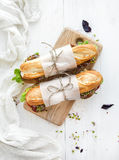 Sandwiches with beef, fresh vegetables and herbs Stock Photo