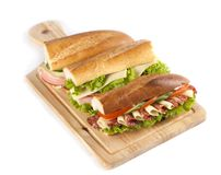 Sandwiches. Big sandwich with fresh vegetables on wooden board stock images