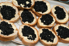 Sandwiches with black caviar Royalty Free Stock Photos
