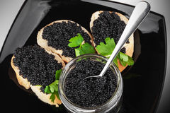 Sandwiches with black caviar on plate Royalty Free Stock Photography