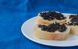 3 sandwiches with black caviar Royalty Free Stock Images