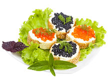 Sandwiches with black and red caviar Stock Images