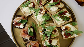 Sandwiches with black and white bread. And sun dried tomatoes stock footage
