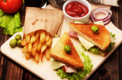 Sandwiches with bread tomato, lettuce and cheese Royalty Free Stock Photo