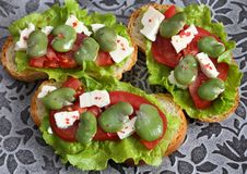 Sandwiches  with broad bean. Sandwiches with broad beans, tomatoes and goat cheese stock images