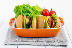 Sandwiches burgers with yellow and black tomatoes, juicy cutlet, avocado Stock Image