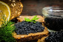 Sandwiches with caviar. Preparation of sandwiches. Place for your text royalty free stock images