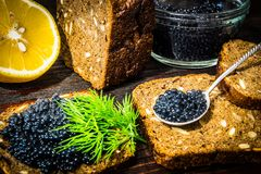 Sandwiches with caviar. Preparation of sandwiches. Place for your text royalty free stock image