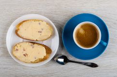 Sandwiches with cheese, coffee espresso in cup, spoon on table. Top view royalty free stock images