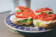 Sandwiches with cheese, lettuce and tomato on a plate Stock Photos