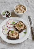 Sandwiches with chicken liver pate and radishes in olive Board Stock Images